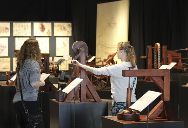 This is an image of guests interacting with Da Vinci's inventions.