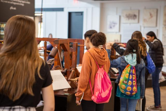 school kids try hands-on exhibits at the da Vinci exhibit
