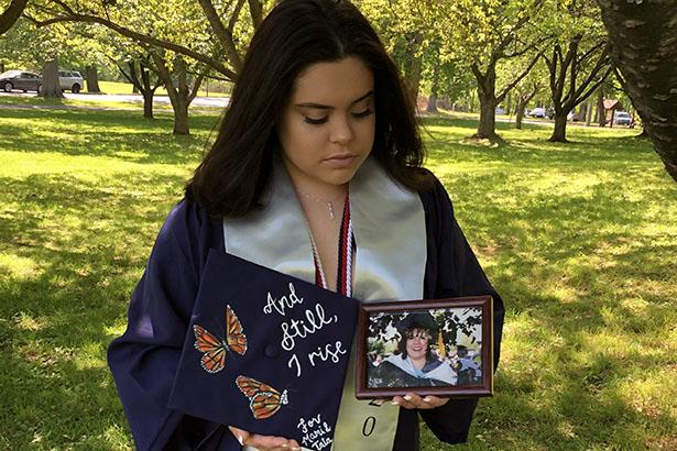 Daniela Derius Rodriguez, Kean Class of 2020, poses with a photo of her mother.