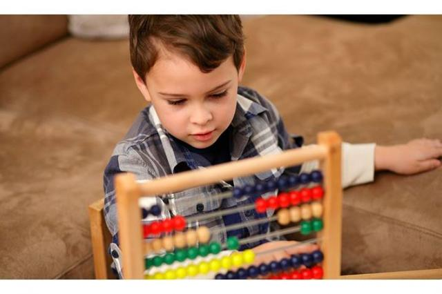 Autistic child uses abacus for treatment