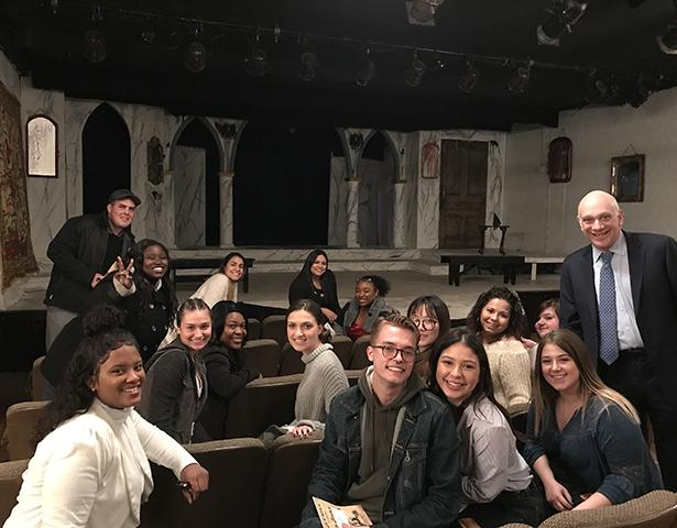 Kean Adjunct English Professor Jeffrey W. Herrmann in a theatre with his Shakespeare Survey class