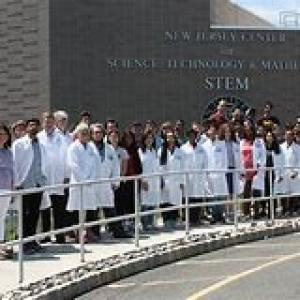 stem group photo of faculty in white coats