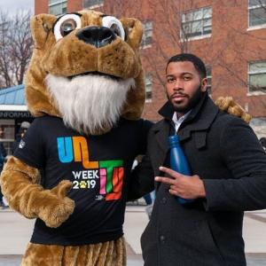 Cougar poses with Kean student for Unity Week