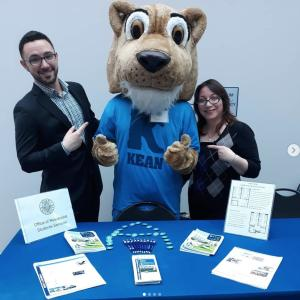 Kean Cougar and admissions staff