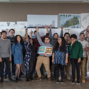 Kean Architecture students strike a pose with their original renderings