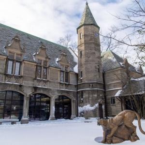 Kean Hall exterior with Cougar statue in the snow